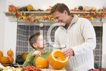 Royalty Free Photo of a Father and Son Carving Pumpkins