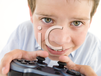 Royalty Free Photo of a Boy Playing a Video Game