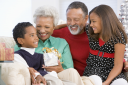 Royalty Free Photo of Grandparents and Grandchildren at Christmas
