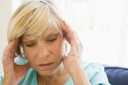 Royalty Free Photo of a Woman With a Headache