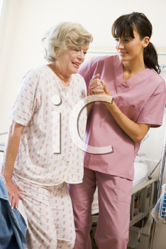 Royalty Free Photo of a Nurse Helping a Patient Walk