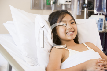 Royalty Free Photo of a Young Girl in a Hospital Bed