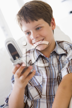 Royalty Free Photo of a Young Boy Texting