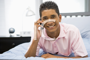 Royalty Free Photo of a Teenage Boy Talking on a Cellphone