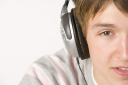 Royalty Free Photo of a Boy Listening to Headphones