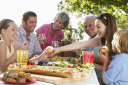 Royalty Free Photo of a Family Dining Outside