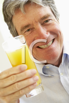 Royalty Free Photo of a Man Drinking Juice