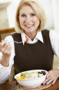 Royalty Free Photo of a Woman Eating Salad