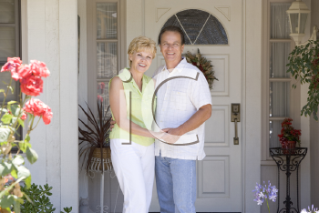 Royalty Free Photo of a Couple Outside Their Home