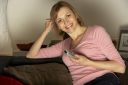 Royalty Free Photo of a Woman Watching TV
