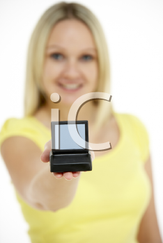 Royalty Free Photo of a Woman Holding a Model Computer