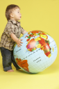 Royalty Free Photo of a Toddler With a Globe