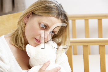 Royalty Free Photo of a Sad Mother in a Nursery