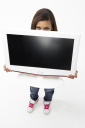Royalty Free Photo of a Girl Holding a TV