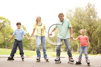 Royalty Free Photo of a Family on Roller Blades