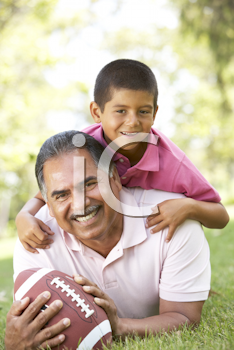 Royalty Free Photo of a Grandfather and Grandson With a Football