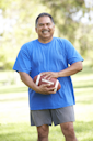 Royalty Free Photo of a Man With a Football