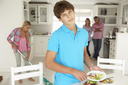 Teenagers reluctantly doing housework