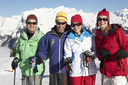 Group Of Middle Aged Couples On Ski Holiday In Mountains