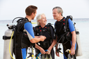 Senior Couple Having Scuba Diving Lesson With Instructor