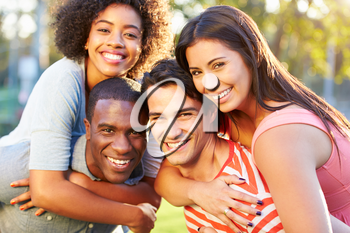 Outdoor Portrait Of Young Friends Having Fun In Park