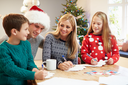 Family Writing Christmas Cards Together