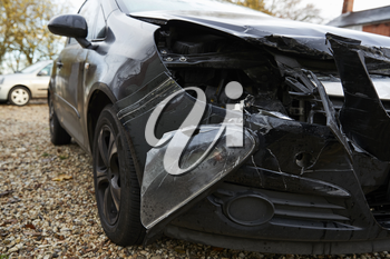 Close Up Of Damaged Car After Road Accident