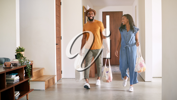 Couple Carrying Reusable Cotton Shopping Bags Retuning Home