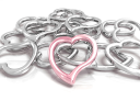 Royalty Free Clipart Image of Metallic Hearts With a Pink One in the Foreground