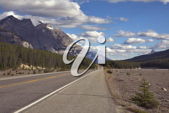 Royalty Free Photo of a Highway By the Rocky Mountains
