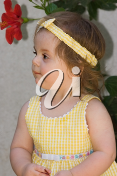 Little girl looking reflectively