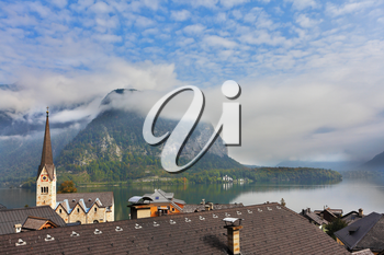The most picturesque small town in Austria - Hallstatt. Slender bell tower and the church on the shore of Lake Hallstatt