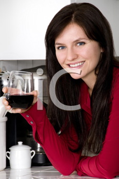 Royalty Free Photo of a Woman Drinking Red Wine