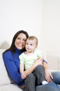 Royalty Free Photo of a Woman Sitting Holding a Baby