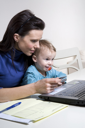 Royalty Free Photo of a Mom With a Child at the Computer