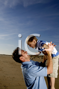 Royalty Free Photo of a Man and Father Playing