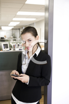 Royalty Free Photo of a Woman Texting in the Office