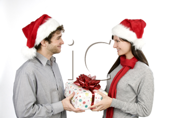 Royalty Free Photo of a Couple Holding a Christmas Gift