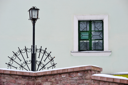 Royalty Free Photo of a Window, Brick Wall and Lamppost