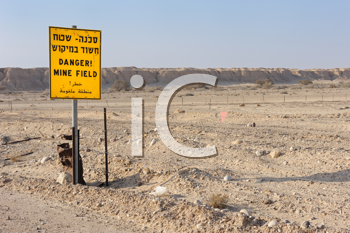 Royalty Free Photo of a Sign Warning There May Be Mines