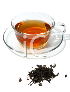 Royalty Free Photo of Tea Leaves and Tea in a Clear Cup