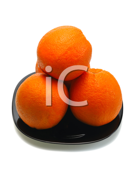 Royalty Free Photo of Oranges on a Black Plate