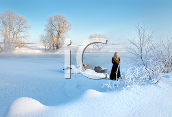 Royalty Free Photo of a Frosty Winter Scene With a Girl Standing in the Distance