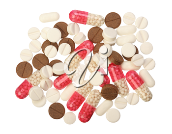 Several white, red and brown pills on a white background, isolated