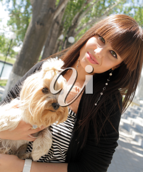 Fashion portrait of beautiful woman with small dog