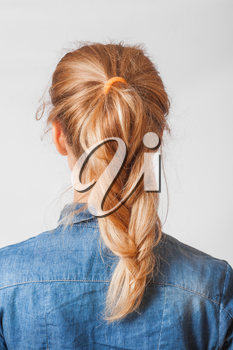 back view of the blond haired female with braid (pigtale), head and  shoulders shot