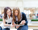 Collaboration concept. Two women reading interesting book