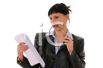 Royalty Free Photo of a Businesswoman Looking at Documents