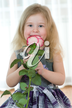 beautiful little girl with pink of rose