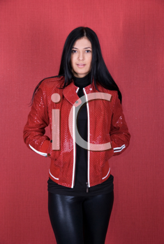 Royalty Free Photo of a Woman Wearing a Red Jacket